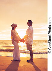 Mature Couple Enjoying Sunset - Romantic Mature Couple...