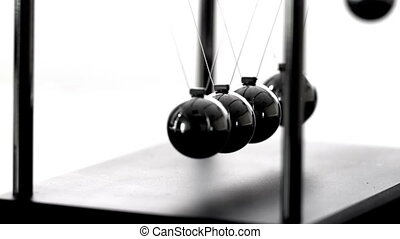 Newtons cradle in motion on white background in slow motion
