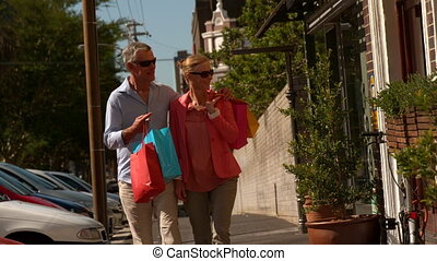 City couple window shopping on sunny day in slow motion