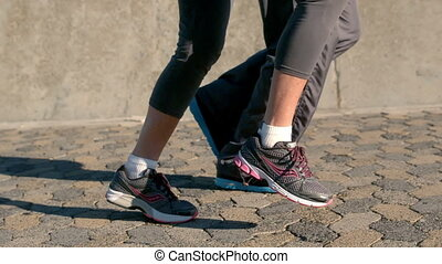 Senior couple jogging legs only in slow motion