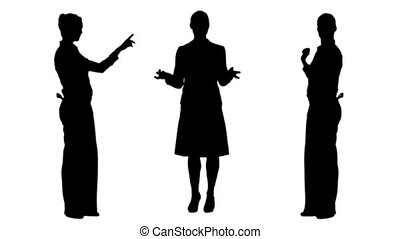 Silhouettes of businesswomen presenting and speaking on...