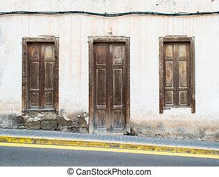 Wooden Door On Slopey Hill - Old Wooden Door and Shutters on...