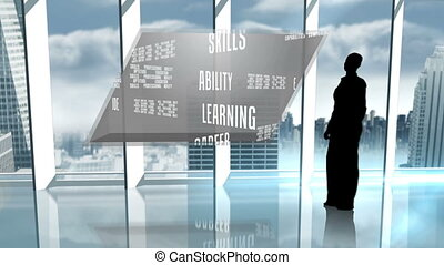 Silhouette of businesswoman presenting business buzzwords...