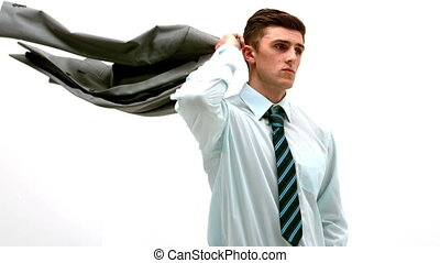 Businessman putting jacket over his shoulder in slow motion