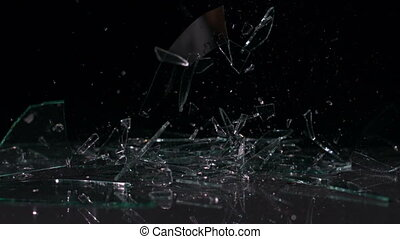 Glass falling and smashing into pieces in slow motion