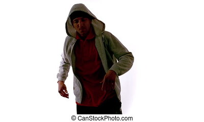 Cool young break dancer moving on white background in slow...