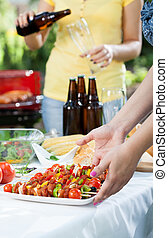 Party in a garden with barbecue, vertical