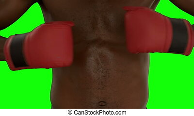 Boxer punching his fists together in slow motion