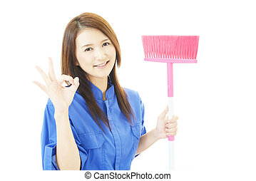 Janitorial cleaning service - The female worker who poses...