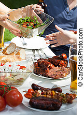 Snacks on a garden party - Vertical view of snacks on a...