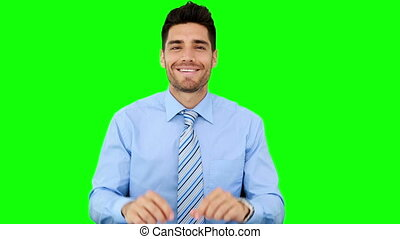Businessman talking to the camera on green screen background