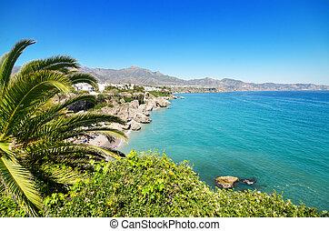 Nerja coastline landscape, famous touristic town in costa del sol, Málaga, Andalusia, Spain.