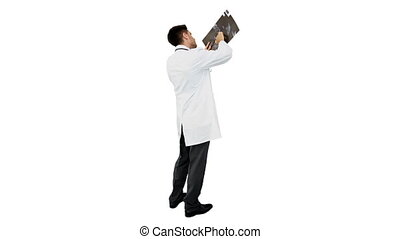 Young doctor standing with xray on white background