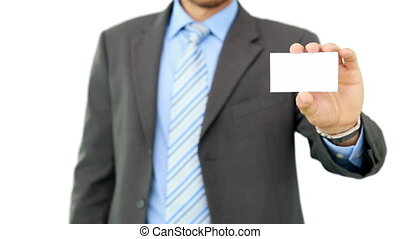 Young businessman showing card to camera on white background