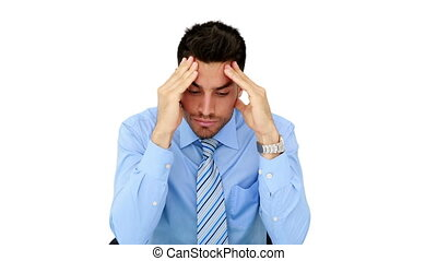 Young businessman getting a headache on white background