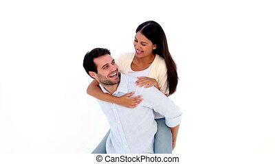 Attractive young couple having fun on white background