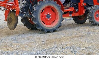 tractor running through the constru