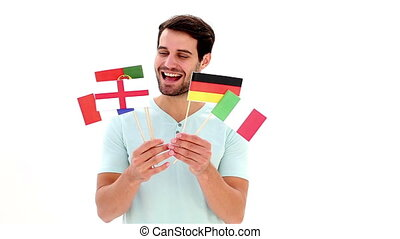 Handsome young man showing flags on white background