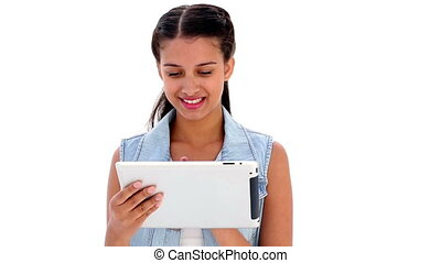 Pretty young brunette using tablet pc on white background