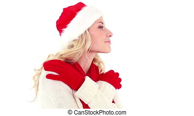 Festive young blonde smiling at camera on white background