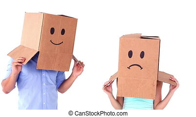 Young couple wearing emoticon boxes