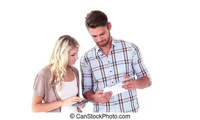Attractive young couple working out finances on white...