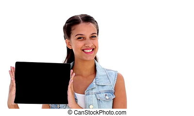Pretty young brunette showing tablet pc on white background