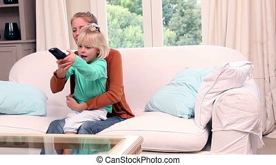 Cute little girl watching tvwith h - Cute little girl...