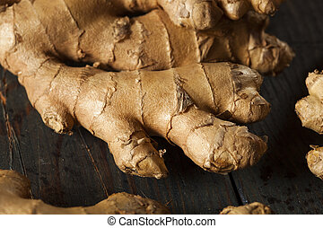 Raw Organic Ginger Root on a Background