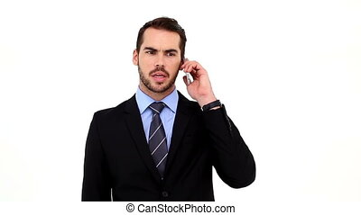 Angry businessman talking on his phone on white background