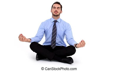 Businessman sitting in lotus pose on white background