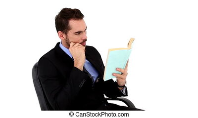 Young businessman reading a book on white background