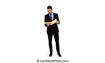 Young businessman reading a file on white background