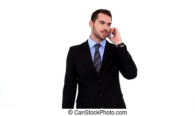 Young businessman talking on his phone on white background