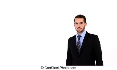 Confident businessman smiling at camera on white background