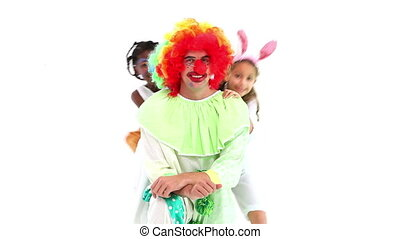 Cute children posing with funny clown on white background