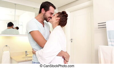 Attractive couple hugging in the morning at home in the...