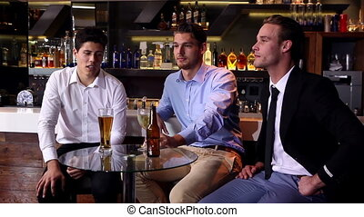 Male friends enjoying a beer