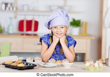 Girl With Hands On Chin Leaning On Kitchen Counter While Baking