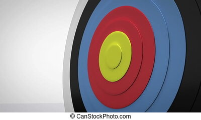 Arrow flying towards dart board and hitting target on white...