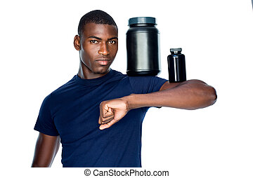 Fit man holding bottles with supplements on his biceps