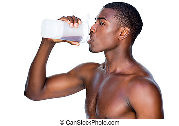 Side view of a sporty man drinking protein - Side view of a...