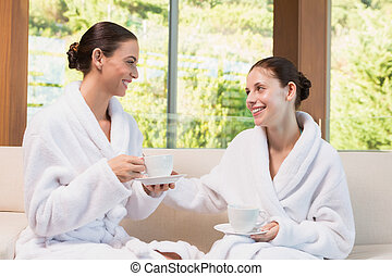 Smiling women in bathrobes