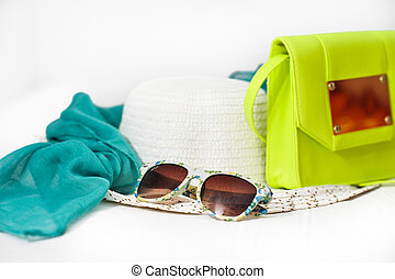 Hat, bag, scarf, sunglasses isolated on a white background...