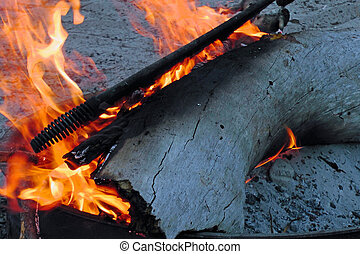 Fire pit showing logs and flames
