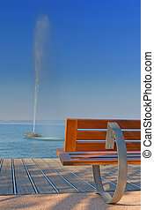 Modern bench and fontain in the lake - Modern benches along...