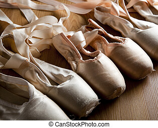 Old Ballet Shoes or slippers - A group or background of used...