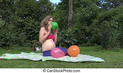 pregnant woman balloon - Attractive pregnant woman girl blow...