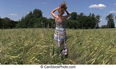 pregnant woman walk field - Pregnant woman walk barley...
