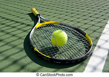 Tennis Racket and ball on white - A tennis ball and racket...